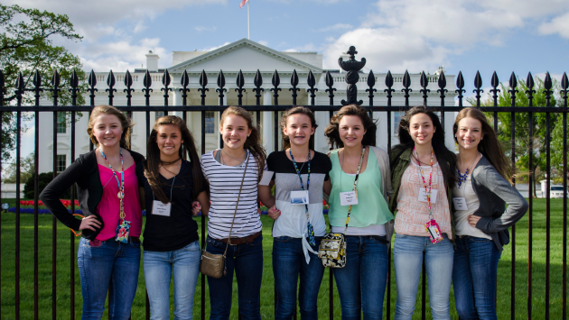 Group of female students standing together posting in front of the White House