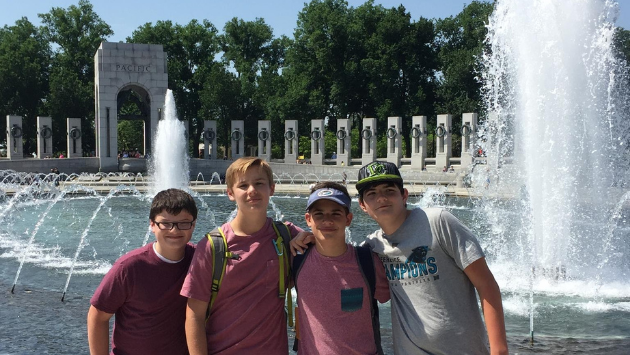 students in front of wwii memorial