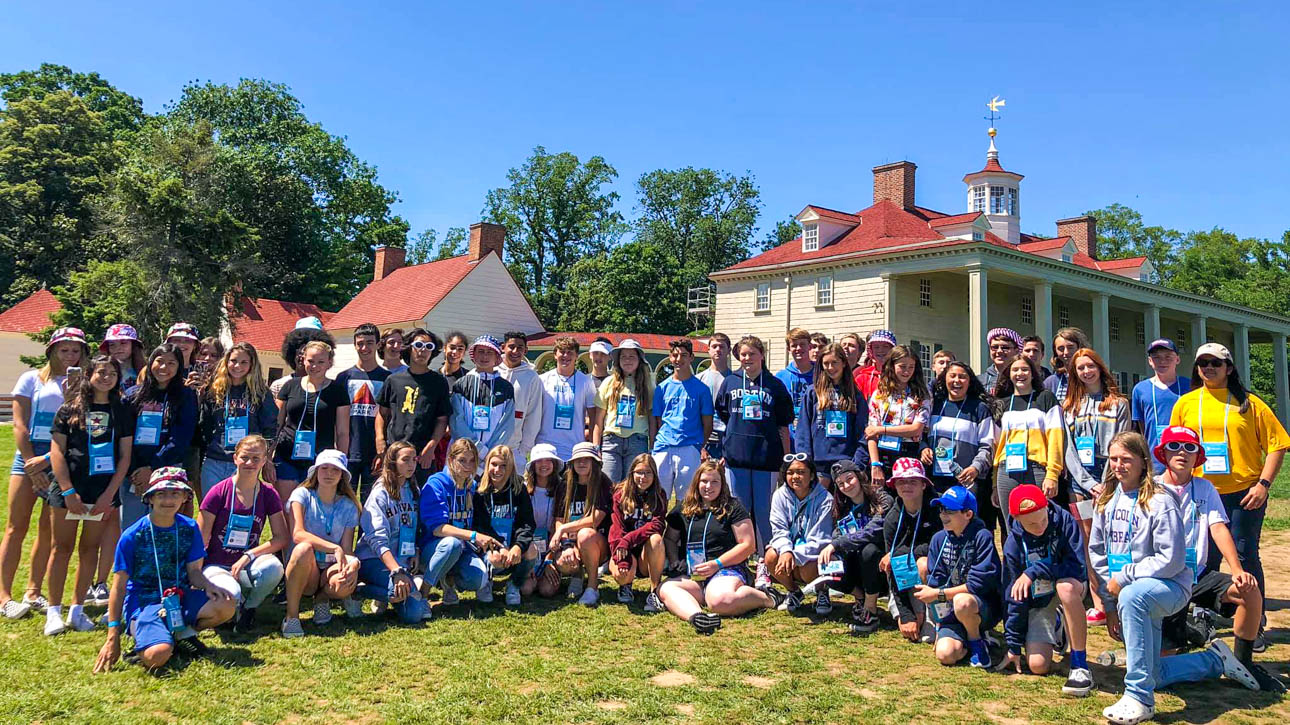 Group of students taking a group photo at Mount Vernon