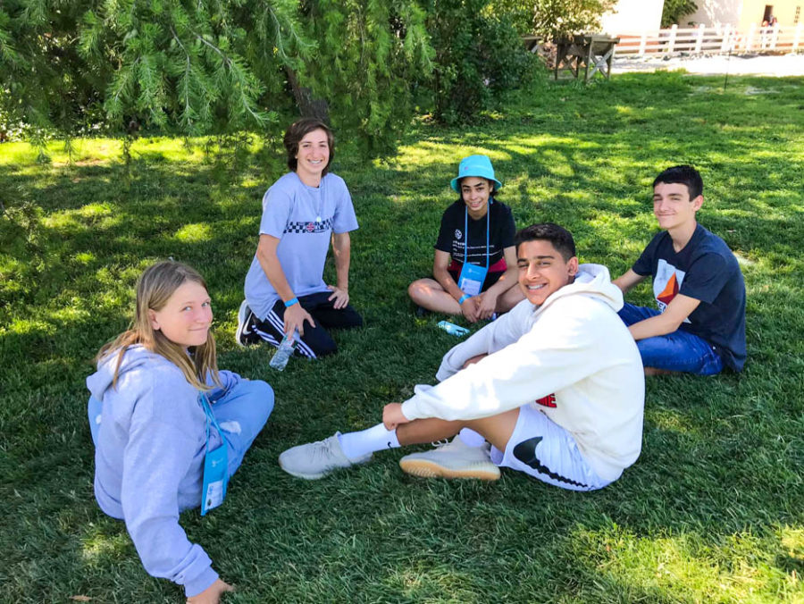 Students sitting in a grassy field