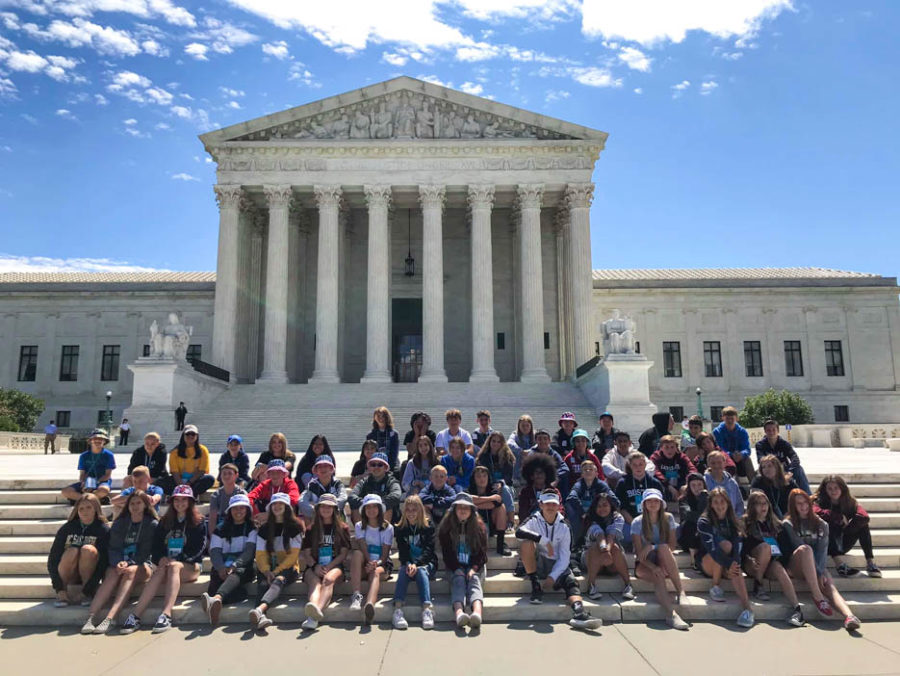 Large group of students gathered on the steps outside of the Lincoln Memorial