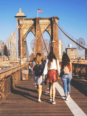 Girls walking on the Brooklyn Bridge