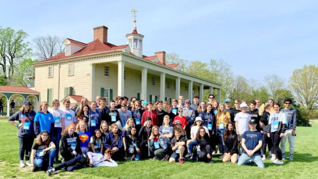 students on an educational tour posing in front on Mount Vernon
