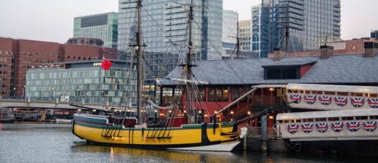 Boston harbor with historical ship