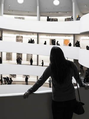 Person looking at art in the Guggenheim Museum