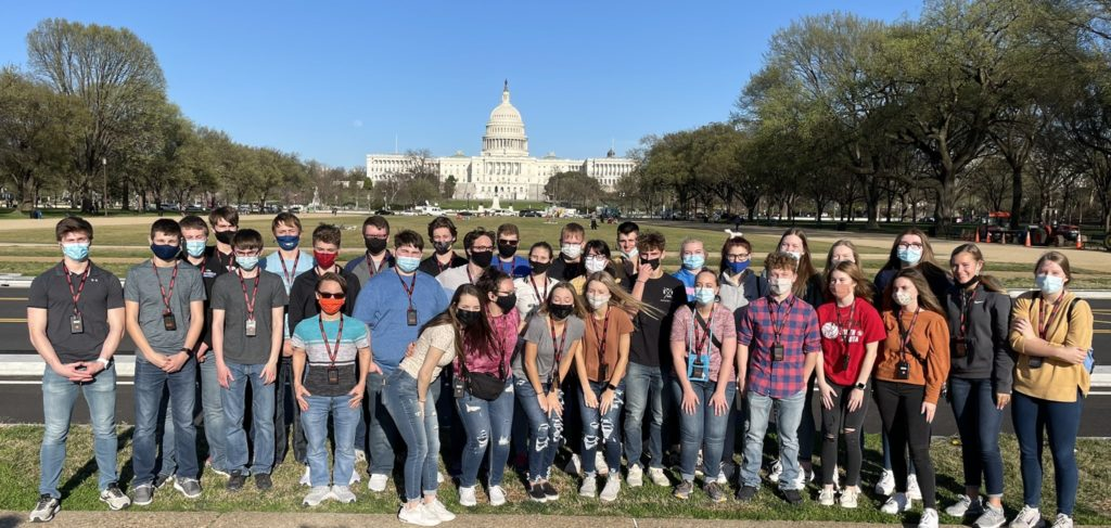 students on an educational tour in front of the US Capitol